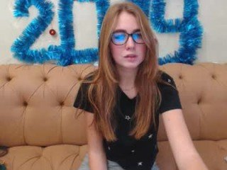 Webcam Belle - sandrabart redhead vixen she takes her sexy lingerie set off and even rubs her shaved pussy to taste her own love juices online